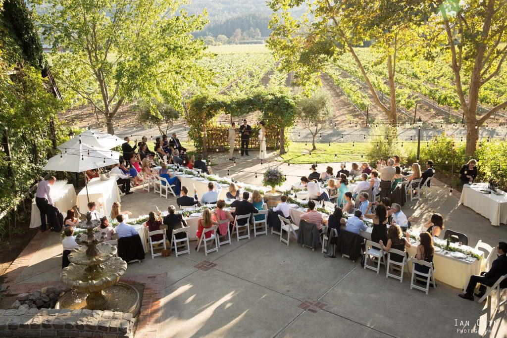 harvest inn wedding tables of wedding guests on the patio and the winery in the background