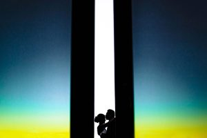 thomas fogarty wedding silhouetted bride and groom with a colorful sunset around them