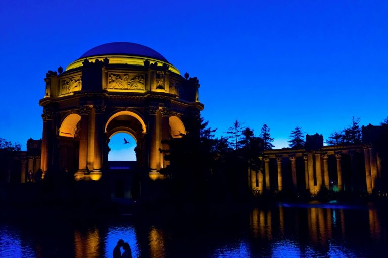 silhouette of couple touching foreheads at the Palace of Fine Arts in San Francisco at dusk