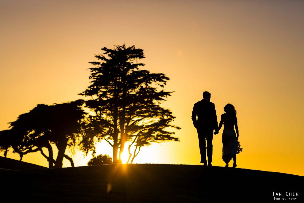 olympic club wedding sunset sihouette with the bride and groom walking