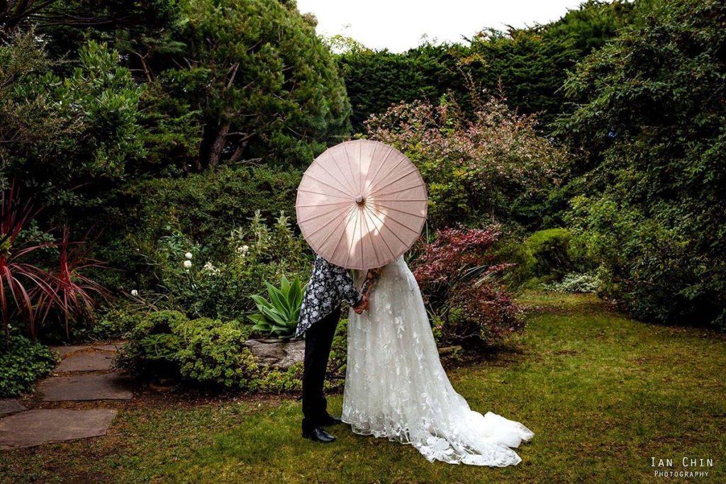 hastings house garden wedding parasol kiss