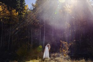 lake tahoe elopement photographer spooner lake wedding bride and sun flare in image