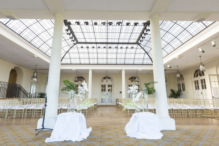 the olympic club wedding venue in san francisco white columns and huge natural light with the skylight on the ceiling