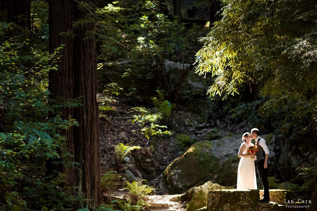 ralston white retreat wedding bride and groom kissing in the sunlight amongst trees