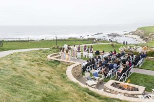 Ritz Carlton Half Moon Bay Wedding ceremony in foreground and ocean in the background