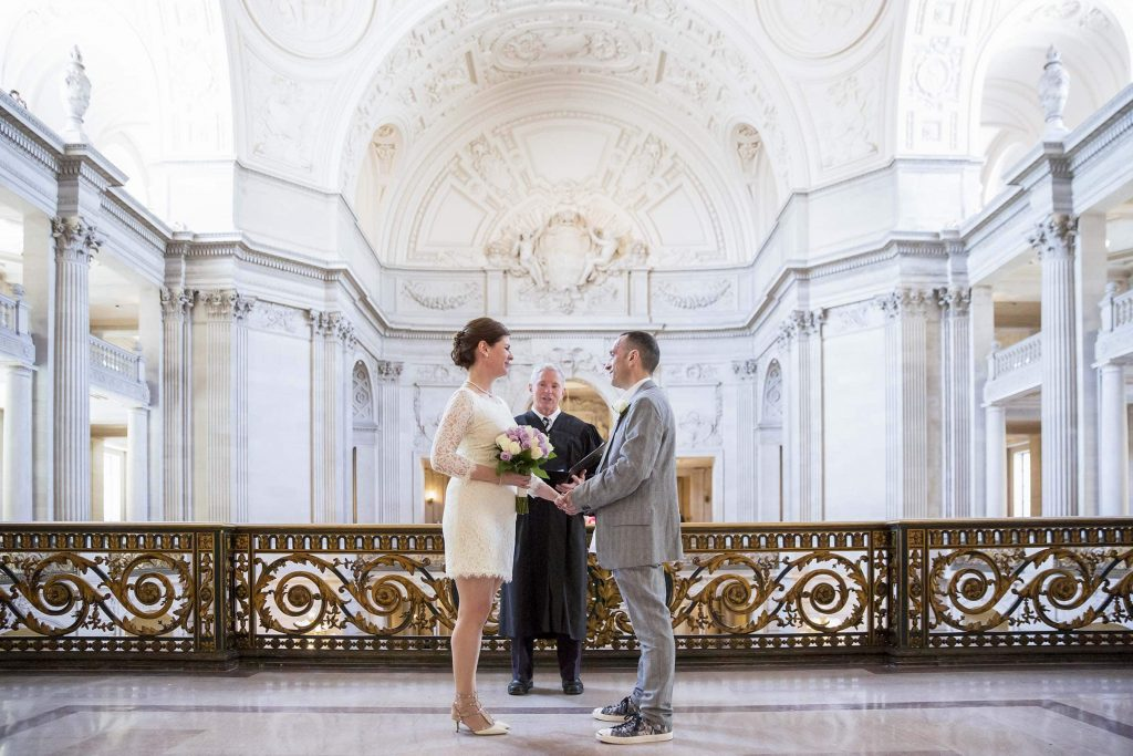 san francisco city hall mayor's balcony bride and groom all alone looking at each other